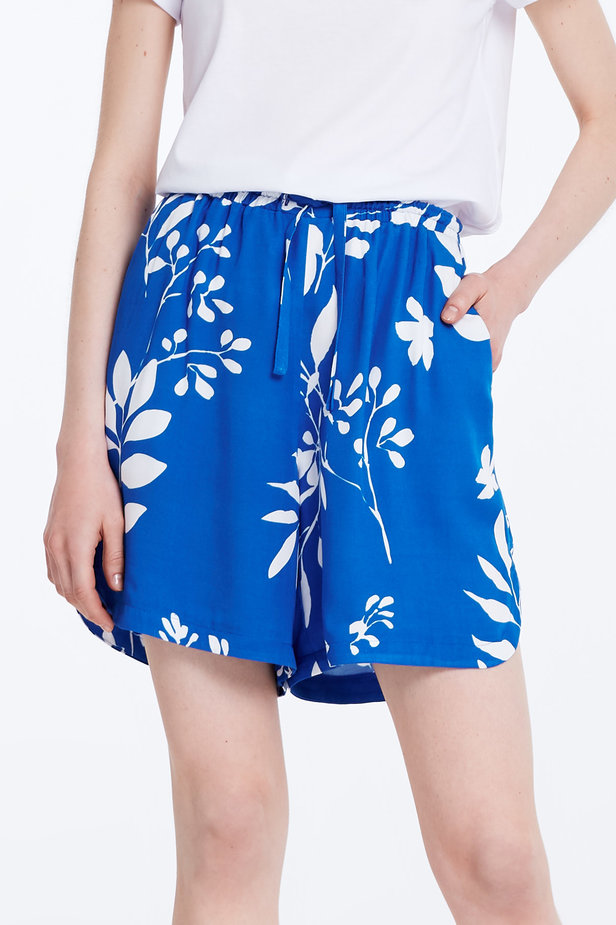 Blue shorts with white leaves photo 1 - MustHave online store