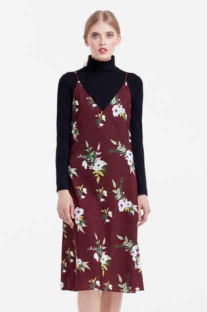 Below the knee brown sundress with a floral print
