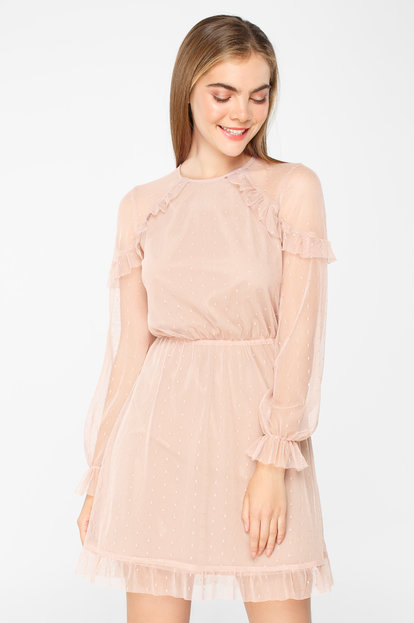 Pale pink tulle dress above the knee with ruffles