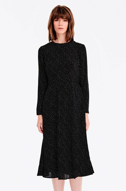 Midi black dress with a white polka dot print