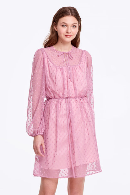 Pink dress with a polka dot print and ties