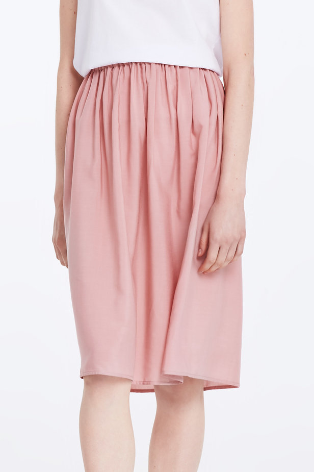 Below the knee powder pink skirt with an elastic waistband photo 1 - MustHave online store