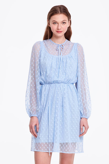 Blue dress with a polka dot print and ties