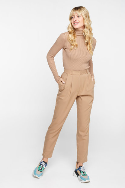 Beige loose trousers