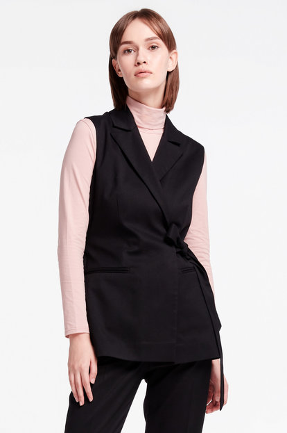 Black wrap vest with a belt