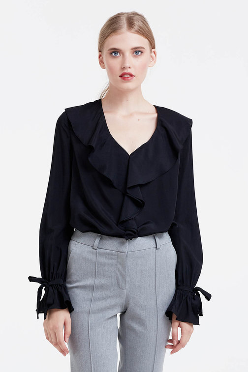 Black blouse with flounces and bows on the sleeves