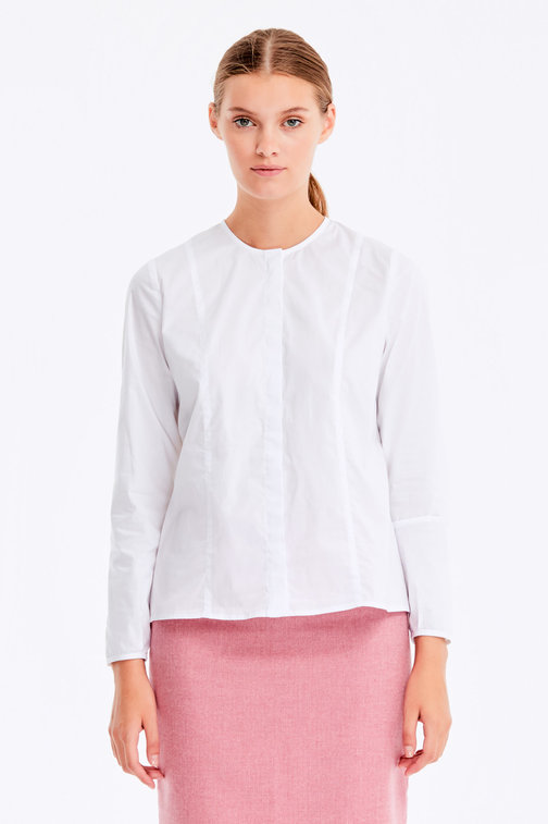 White blouse with a concealed placket