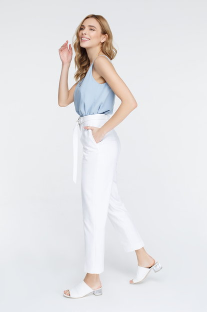 White pants with arrows and belt