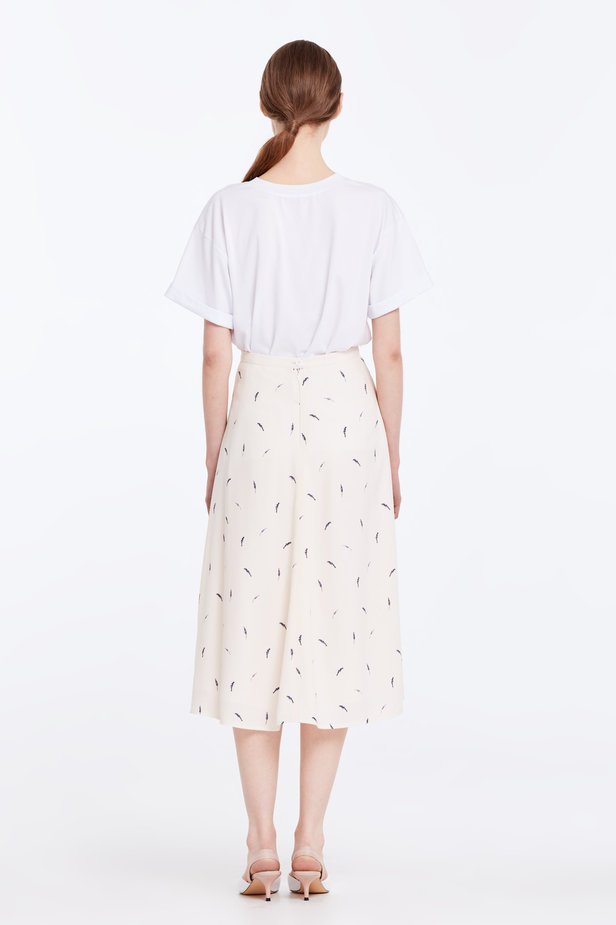 Midi peach-colored skirt with a lavender print photo 7 - MustHave online store
