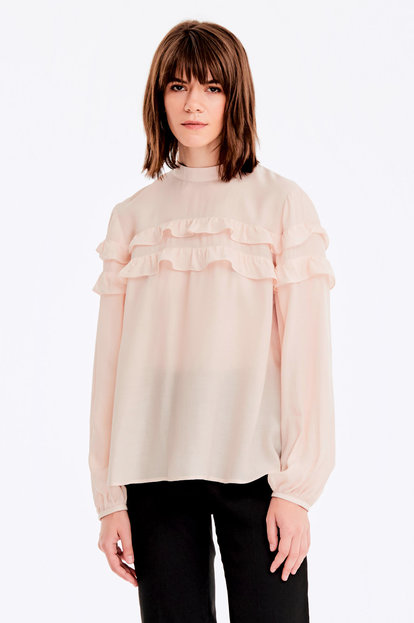 Beige blouse with ruffles
