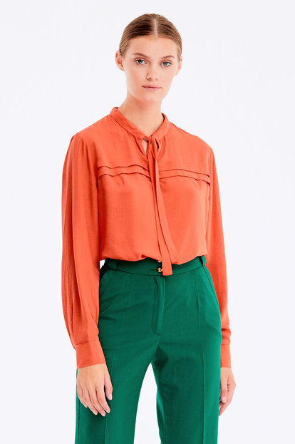 Dark orange blouse with pleats on the chest