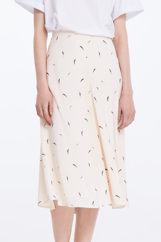 Midi peach-colored skirt with a lavender print photo 1 - MustHave online store