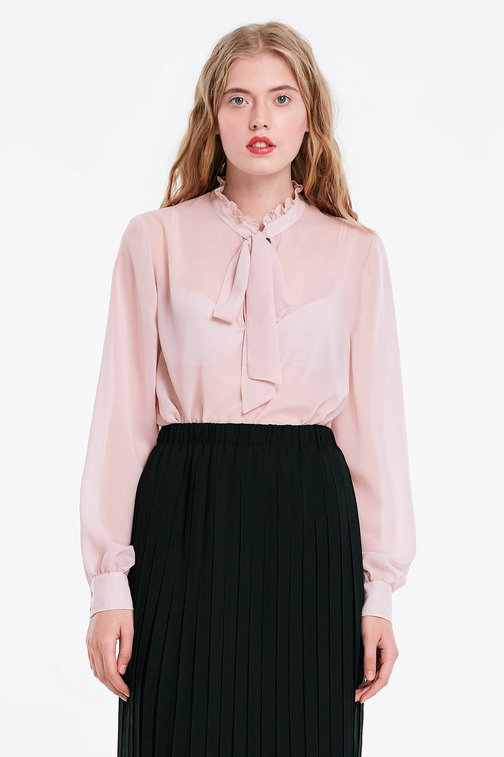 Powder pink blouse with a bow