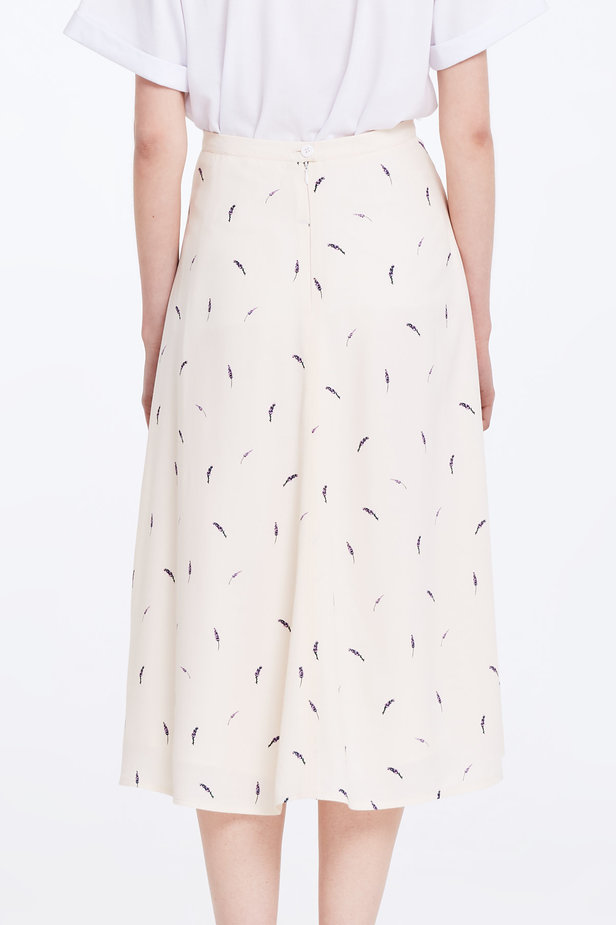 Midi peach-colored skirt with a lavender print photo 6 - MustHave online store
