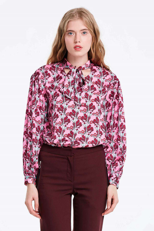 Pink blouse with a floral print and a bow