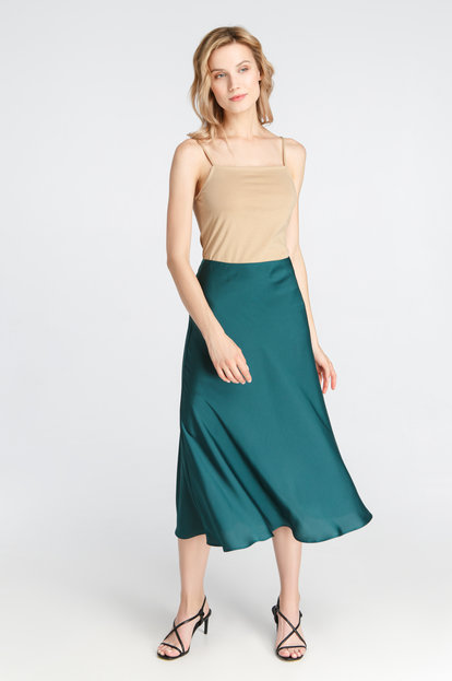 Green satin skirt below the knee